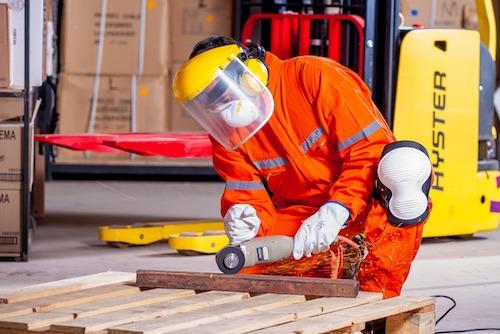 GrowEQ Person in safety gear working on floor