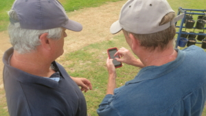 QuickLinks: Matt Murphy explaining the app to a client on the golf course